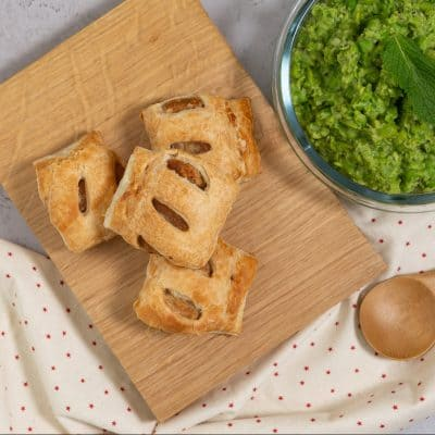 Vegan sausage rolls with mushy peas and mint